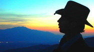 Stock Video Footage of Cowboy Plays Guitar on Mountain at Sunset 08