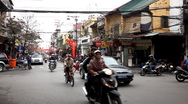 Streets of Hanoi in a busy day, Motocycles and cars traffic in Old Town, Vietnam Stock Footage