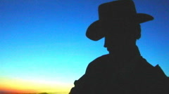Cowboy Plays Guitar on Mountain at Sunset 6 Stock Footage
