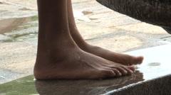 Washing feet Stock Footage