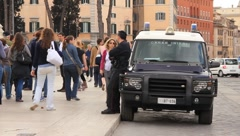 Italian Policeman watching pedestrians in Rome Stock Footage