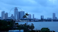 Singapore Skyline Dusk, Flyer, Marina Bay, Benjamin Sheares Bridge, Skyscrapers Stock Footage