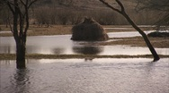 Water in field with haystack Stock Footage