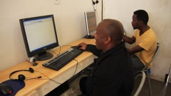 Young Black Men at a Primitive Computer Center (HD) co Stock Footage