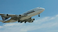 Stock Video Footage of 747 LANDING SLO-MO