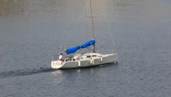 A Sailboat Motors Throught the Water (HD) co Stock Footage