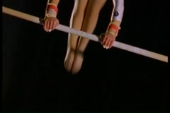Female gymnast doing routine on parallel bars Stock Footage