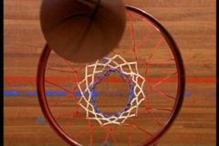 View from above the rim of basket and net of ball going through - stock footage