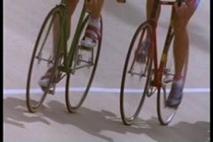 Close on bike racers pedaling on track - stock footage