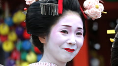 Beautiful Japanese Geisha girl enjoying having her Photograph taken, Japan, Asia - stock footage