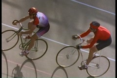 Following shot of bicycles racing and bike racers on track Stock Footage