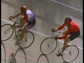Stock Video Footage of Following shot of bicycles racing and bike racers on track