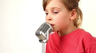 Girl sing in microphone Stock Footage