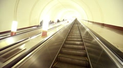 Escalator carry commuters up from metro station subway Stock Footage