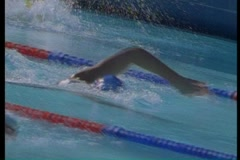 Swimmers in pool in an Olympic style race Stock Footage