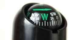 Closeup of compass turn around Stock Footage
