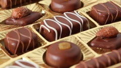 Closeup of sweet chocolates in golden box - stock footage