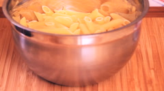 cooking 0022-penne in a bowl - stock footage