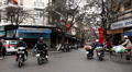 Streets of Hanoi in a busy day, Motocycles and cars traffic in Old Town, Vietnam Footage