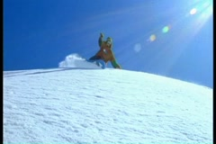 Snowboarder doing stunts on a snowy slope Stock Footage