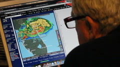 Man checks weather radar on his laptop computer Stock Footage