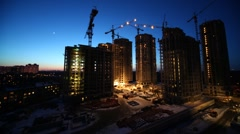 Overview of construction site in evening, time lapse Stock Footage