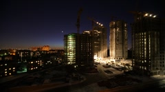 Overview of construction site in night, time lapse Stock Footage