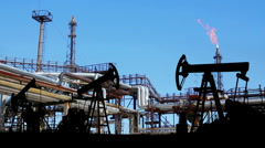 Petrochemical factory and oil pumps silhouette Stock Footage
