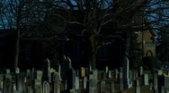 Old cemetery and church night Stock Footage