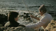 Grandfather and grandson fishing Stock Footage