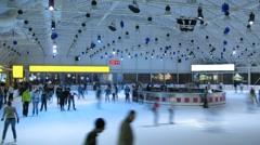 People skate on ice rink European Stock Footage