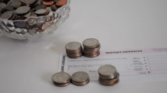 Coins for deposit in a bank Stock Footage