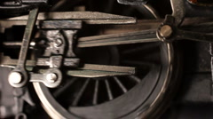 Miniature steam locomotive driving wheels start turning accelerate and stop Stock Footage