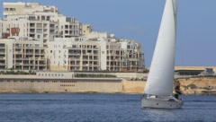 Sailboat off of Coast of Malta (HD) co Stock Footage