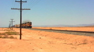 Stock Video Footage of Speeding Freight Train In Desert 1
