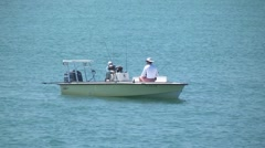 Water scenic  men sitting in a yellow flats boat putting rods away 1 h264 Stock Footage