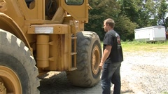 Man Getting In Large Machinery (HD) c Stock Footage