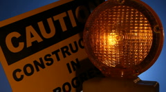 Blinking yellow light with caution sign Stock Footage