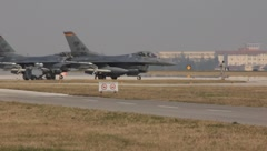 F16's Lining Up on Runway (HD) co Stock Footage