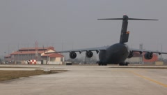Air Force C-17 taxis on runway (HD) c - stock footage