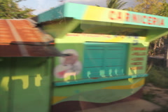 Driving through Dominican town. Houses and shops. SD. Stock Footage