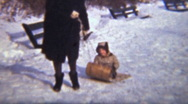 Stock Video Footage of Girl Sledding With Her Mom (1942 Vintage 8mm film)