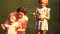 Mother Plays With Her Girls In Summer (1943 Vintage 8mm) Stock Footage