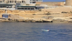 Small and large boats on the Mediterranean Sea on the shore of Malta Stock Footage