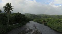 Tahiti river valley faint rainbow Stock Footage