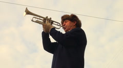Trumpeter playing in the street - stock footage