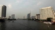 Skyline, Chao Phraya River in Bangkok, Thailand, View from Taksin Bridge, Boats Stock Footage