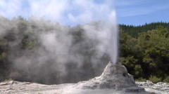 Wide shot geyser erupting Stock Footage
