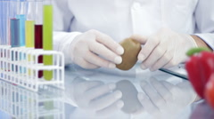 Male scientist with kiwi fruit in his lab Stock Footage