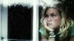 Girl in window Stock Footage